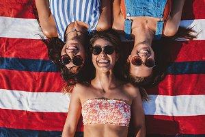 Three girl friends lying
