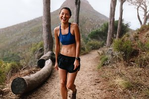 Asian female runner laughing