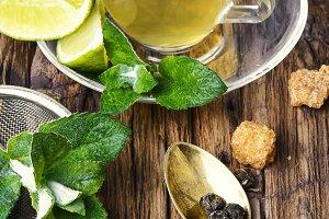 Lemon tea on wood background