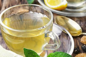 Lemon tea on wood background