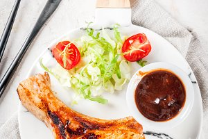 Grilled meat with salad