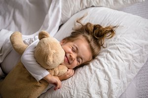 little girl in bed with soft toy the emotions of a child