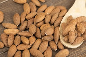 Close-up of almonds on wooden spoon. Food.