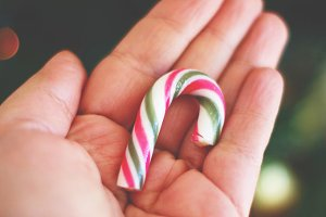 Candy cane on hand