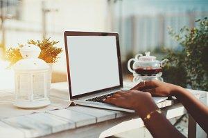 Female hands on laptop keyboard
