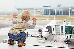 Child look at plane in airport