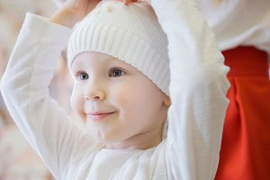 Sweet girl in a white knitted cap