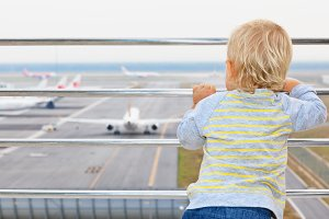 Child look at planes in airport