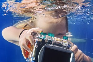 Child with waterproof camera