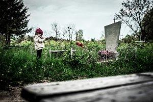 little girl near the grave