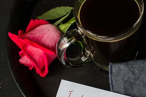Cup of cofee and roses