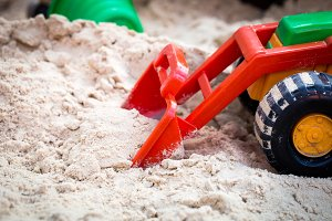 Childrens toy car in sandbox
