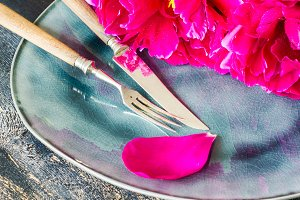 Table setting with bright peonies