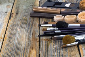 cosmetics on wooden background