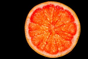cut grapefruit, black background