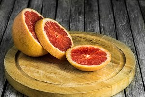 cut grapefruit on a wooden Board