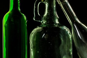 glass bottle, empty, original, on black background