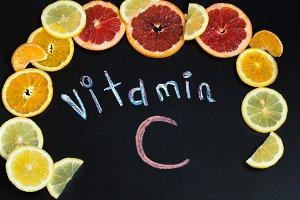 word vitamin C, citrus fruits, the  is written on black chalkboard