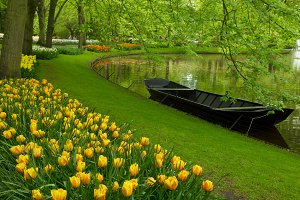 spring garden with canal and boat