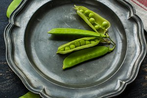 Organic food concept with green peas