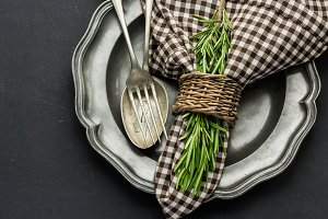 Rustic table setting with rosemary