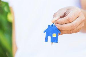 Female hand holding house key