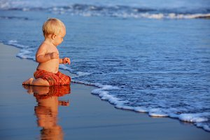 Little child play on beach
