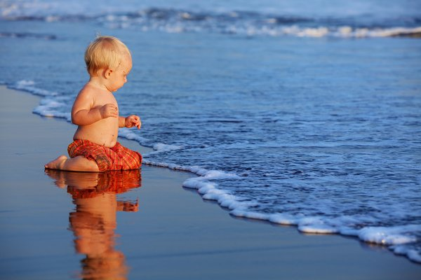 Little child play on beach