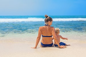 Mother with child on the beach