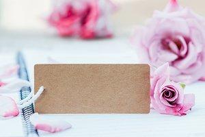 pink rose and cardboard.