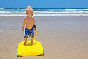 Little surfer with bodyboard
