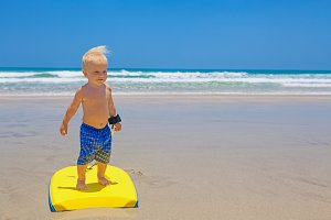 Little boy on bodyboard