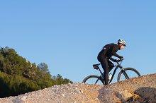 Mountain Bike cyclist up slope