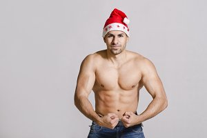 Fitness man with red Santa hat
