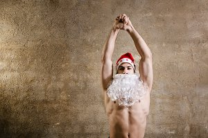Strong posing Santa man