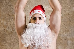 Fit Santa posing on wall
