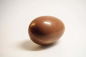 Chocolate egg on a light background
