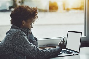 Curly ebony girl with laptop