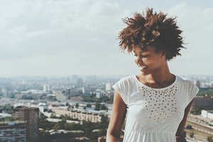 Black girl with cityscape behind
