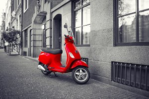 Red vintage scooter selective color