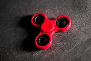 Red spinner Fidget finger stress toy