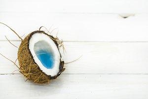 broken coconut, white wooden background
