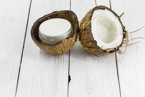 fresh coconut,  cream on a wooden white background