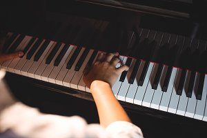 Close-up of woman playing a piano