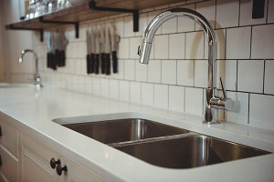 Chrome sink and faucet in professional kitchen