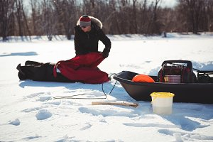 Ice fisherman assembling his tent