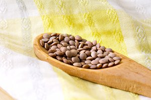 wooden spoon whit lentils