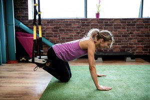 Woman working out with resistance band