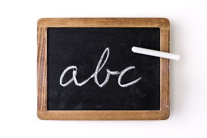 "Letters ""abc"" written on a slate"