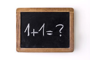 "Question ""1+1=?"" written on a slate"